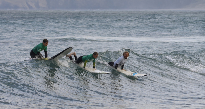 Surf lesson riding unbroken waves